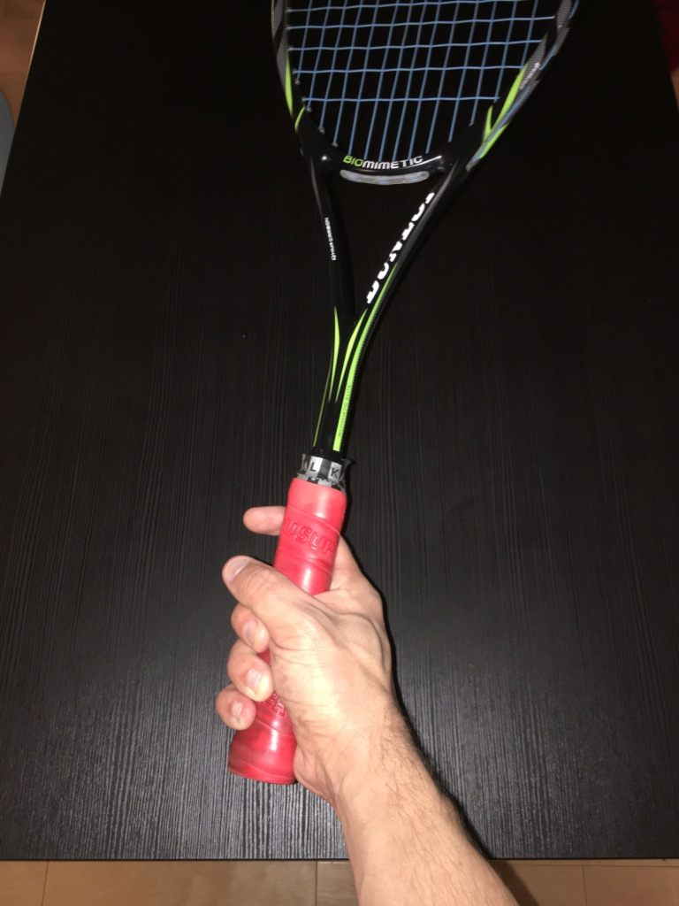 squash positioning of hand on racket 2